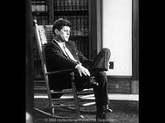 "President John F. Kennedy sitting in a ""figure-four"" stance; generally viewed as a distancing or ""barrier"" position."